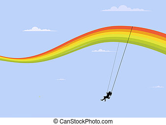 swing - happy girl playing on the rainbow swing