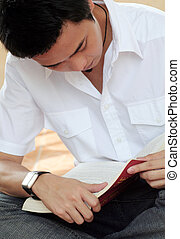 Reading Book - Asian Male reading Book