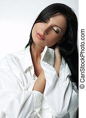 White XXL Shirt - Beautiful brunette woman on bed, wearing...