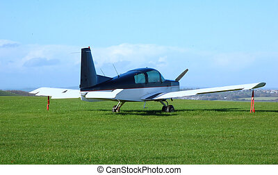 Small Aeroplane - Small aeroplane parked in small airfield...