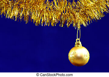 Bauble on Blue - Christmas tinsel and baubles in a warm gold...