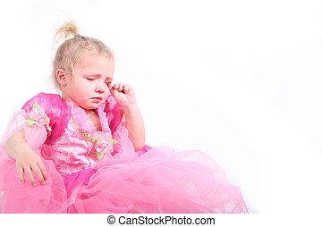 upset toddler - Cute girl in pink princess dress crying.