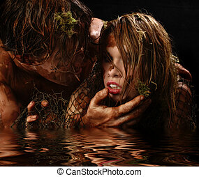 Swamp Creatures - Close up of man and woman covered in mud...