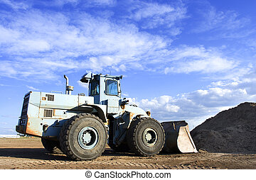 Loader - A front end loader at the work site