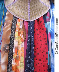 Scarves and Hat - Scarves hanging behind a hat
