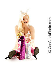 happy bunny girl - happy girl with bunny ears and gifts over...