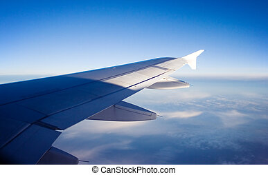 aricraft wing - sky view from aircraft window