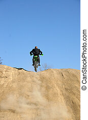 Businessman on Dirt Bike - Thrity something business man in...