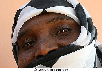 african woman - african muslim woman with a black and white...