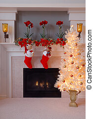 Christmas at Home - Two red fur stockings hang on the...