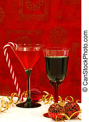 A Holiday Toast - Two colorful cocktails in pretty glasses,...