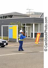 Man directing traffic 2 - Japanese man(DOZO-MAN) directing...