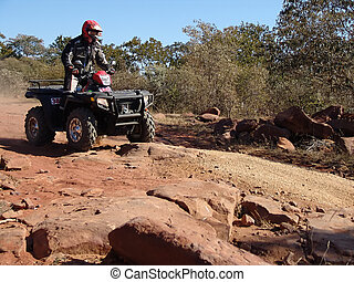 quad motorcycle racing in kalahari desert