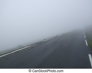 Road in fog - Straight road and a dangerous fog.