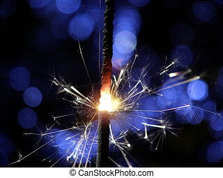 sparkler making fireworks - Sparkler making white and blue...
