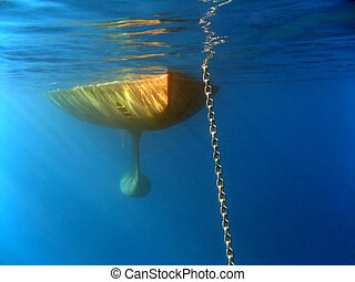 Anchor chain - Underwater shot of a sailing yacht behind the...