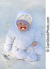 baby in the first snow - adorable little baby bundled up in...
