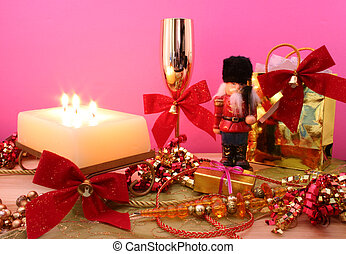 Christmas Gift on Pink Background with Ribbon and Candle