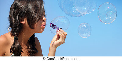 Girl with bubbles - Happy girl playing with bubbles on the...
