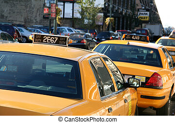 Parked Taxi Cab - Parked Yellow Taxi Cab Waiting for a Fare