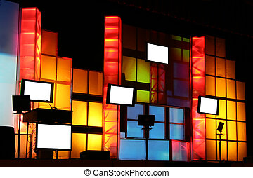 Colorful Stage Production with Blank Monitor Displays