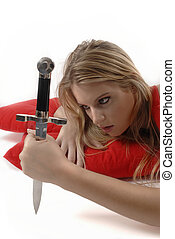 Girl with knife - Girl playing with knife on red pillows