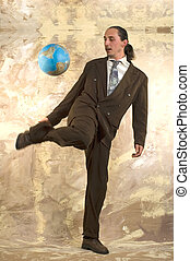 Businessman soccer - Businessman play soccer with globe