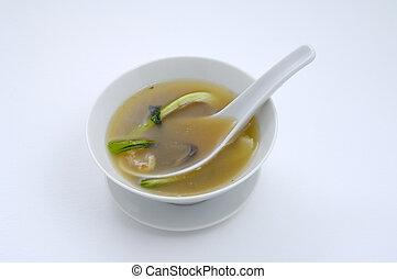 Miso soup - Bowl of soup containing miso, pok choi, chicken...