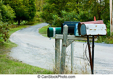 Rural Mail - Row of mailboxes on country road.