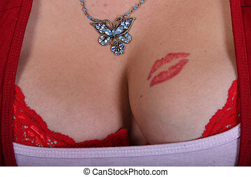 cleavage - a womans very large cleavage with tattoo