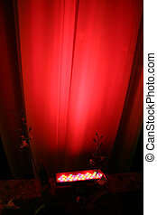 Red Spot Light Against Curtain