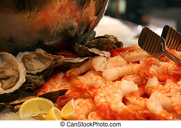 Chilled Seafood Appetizers - Shrimp and Oysters on Ice