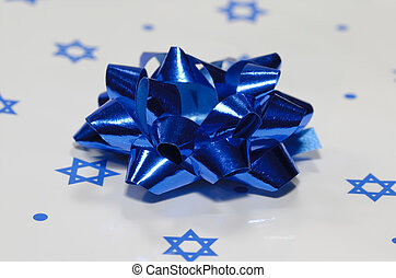 Chanukah Gift - Photo of a Blue Bow on Chanukah Gift...