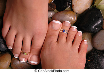 Feet on Pebbles - Pedicured feet on pebbles