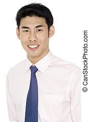 Smiling Businessman - A smiling young asian businessman in...