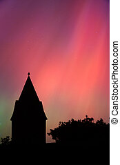 Aurora Borealis - Church Steeple in foreground of Northern...