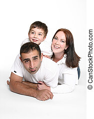 Happy family - Happy relaxed family lying on floor