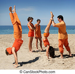 Active family - Family in orange clothes having fun on the...