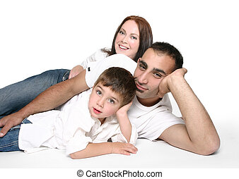 Casual family on floor - Casual family in jeans resting on...