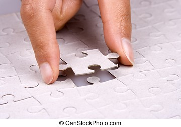 Playing Jigsaw Puzzle - Close up of hand playing jigsaw...