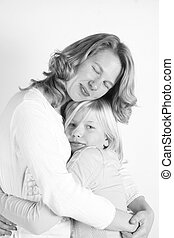 mother and daughter - A beautiful mother and daughter in a...