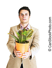 Man with a plant - Young man in pink shirt and beige jacket...