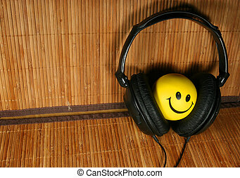 Smiling face and the headphones