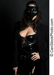 Masquerade - Hot young woman in tight latex dress wearing...
