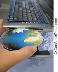 world at your fingertips - hand inserting the world into a...