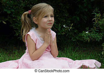 praying girl on the grass