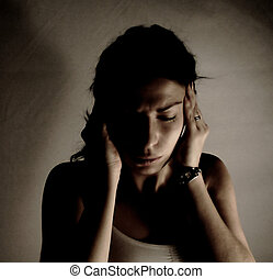 headache - woman having headache, filtered image, dark mood