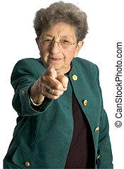 senior woman serious pointing - attractive senior woman...
