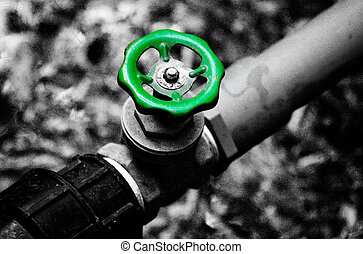 Water Valve - Green water valve and black&white background.