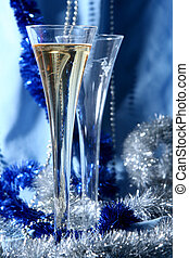 Blue celebration - Glass of champagne on a silver-blue...